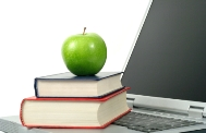 apple with books and laptop